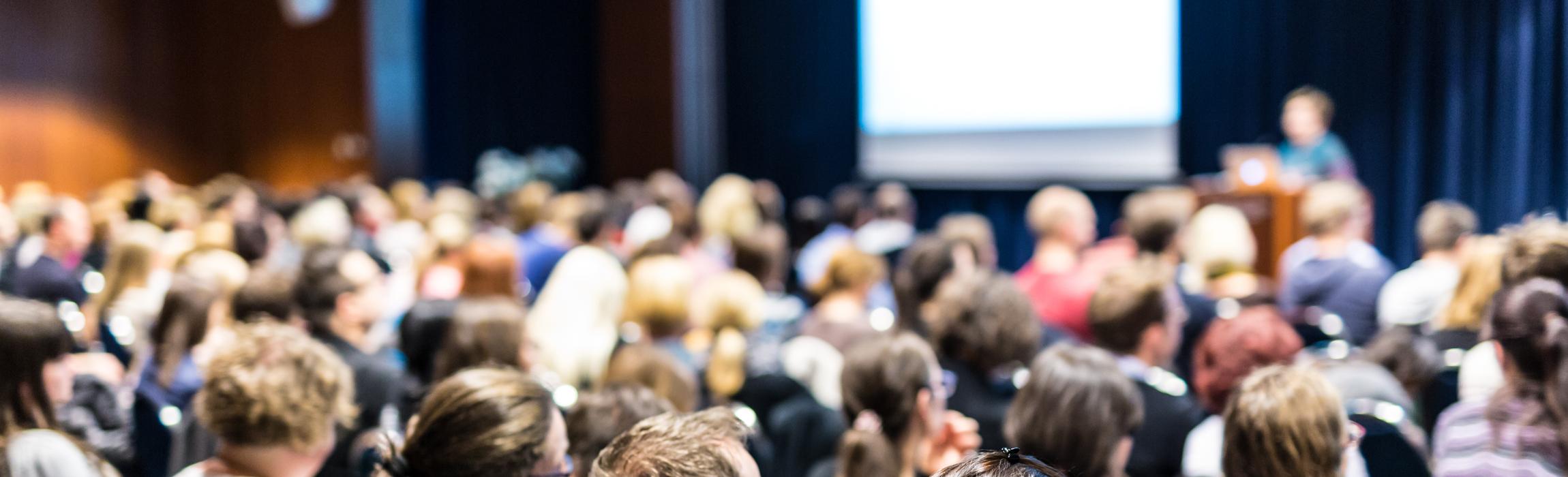 ny-33949342-speaker-giving-presentation-on-scientific-business